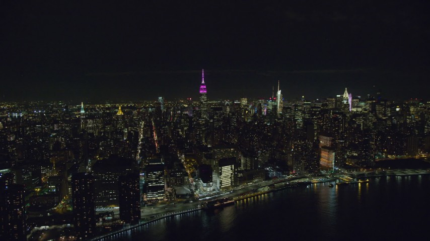 6K stock footage aerial video orbit Midtown high-rises and Empire State Building at Nighttime, NYC Aerial Stock Footage | AX122_077
