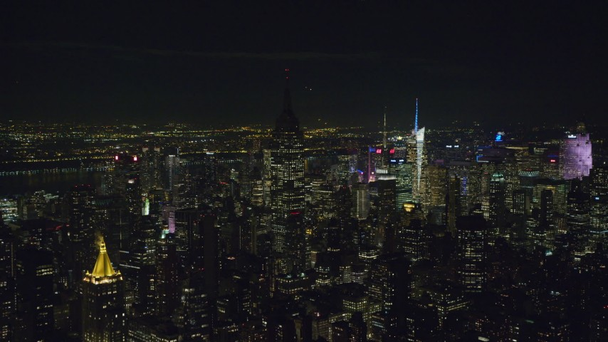 6K aerial video orbit Empire State Building with fading lights at Nighttime in Midtown, NYC Aerial Stock Footage | AX122_081