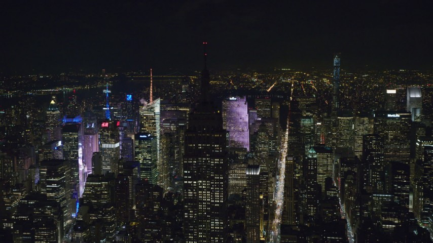 6K stock footage aerial video orbit the Empire State Building with unlit rooftop at Night in Midtown, NYC Aerial Stock Footage   AX122_084