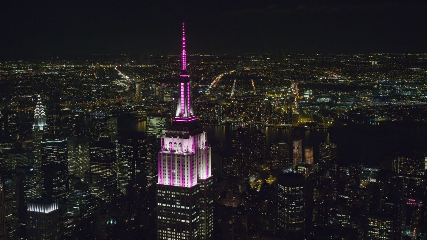 6K aerial video orbit Empire State Building with striped lights at Night, Midtown, NYC Aerial Stock Footage | AX122_087