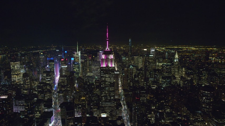 6K stock footage aerial video orbit of the Empire State Building at Nighttime in Midtown Manhattan, NYC Aerial Stock Footage | AX122_090