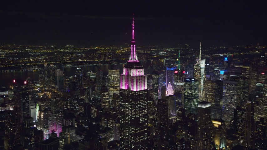Orbit Empire State Building with Red and White Lighting at Night Aerial Stock Footage | AX122_092