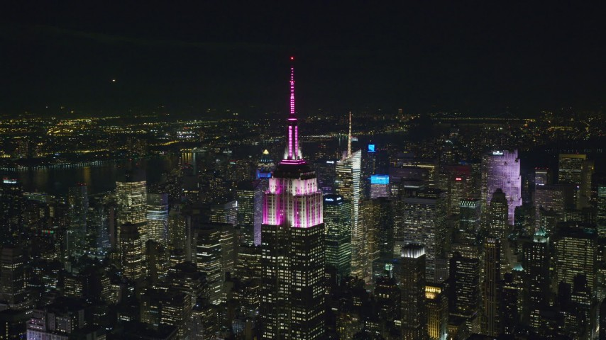 6K stock footage aerial video of circling the Empire State Building at Nighttime in Midtown, New York City Aerial Stock Footage | AX122_109