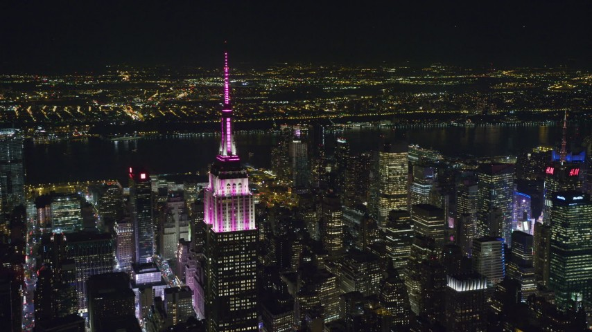 6K stock footage aerial video orbit of the Empire State Building in Midtown at Night, New York City Aerial Stock Footage | AX122_111