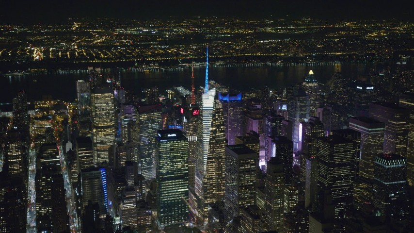 6K stock footage aerial video orbit Bank of America Tower and Midtown skyscrapers at Night, New York City Aerial Stock Footage | AX122_112