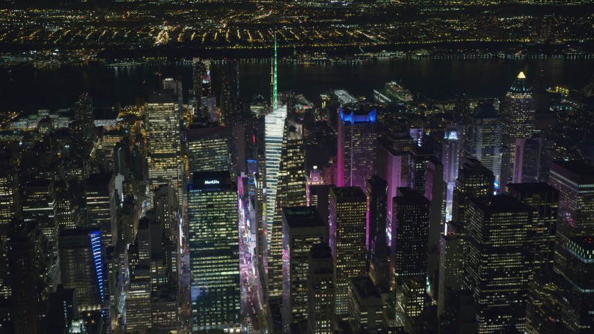 6K stock footage aerial video orbit Bank of America Tower and Times Square at Night in Midtown, NYC Aerial Stock Footage | AX122_113