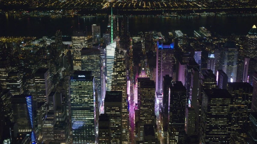 6K stock footage aerial video orbit Bank of America Tower toward Times Square Lights at Night, Midtown, NYC Aerial Stock Footage | AX122_114