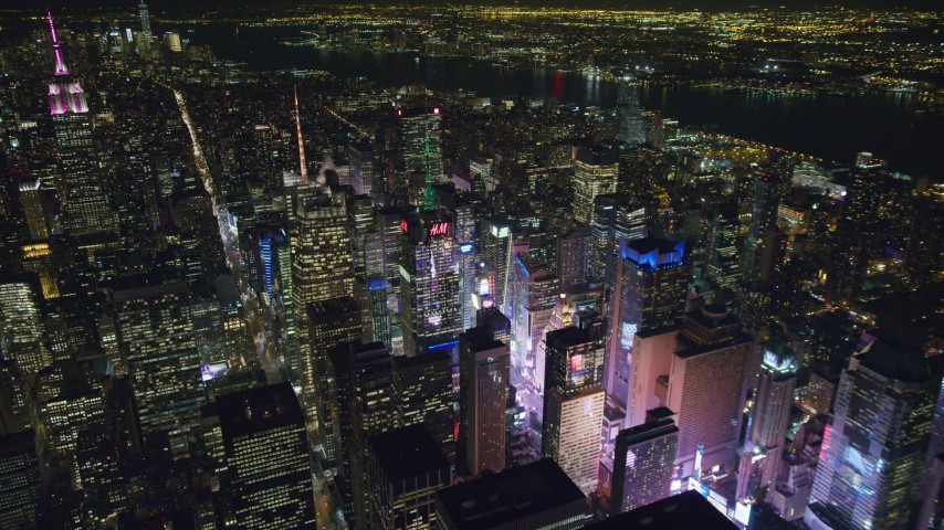6K stock footage aerial video of an orbit of Times Square at Night in Midtown Manhattan, New York City Aerial Stock Footage | AX122_116