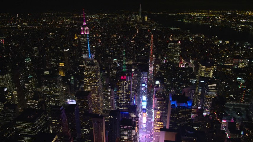 6K stock footage aerial video of circling over Times Square in Midtown at Night, New York City Aerial Stock Footage | AX122_117