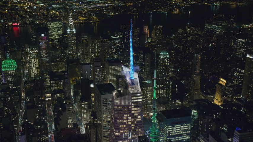 6K stock footage aerial video orbit the top of Bank of America Tower at Night in Midtown, New York City Aerial Stock Footage | AX122_118