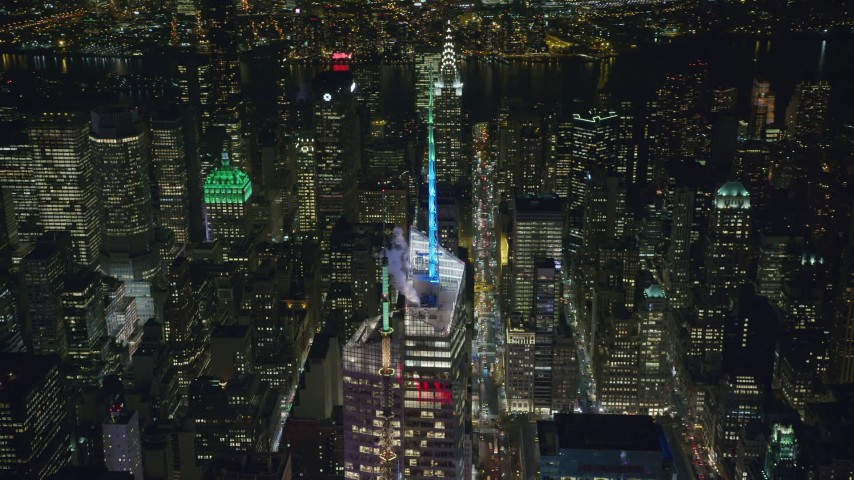 6K stock footage aerial video circle top of Bank of America Tower at Night in New York City Aerial Stock Footage | AX122_119