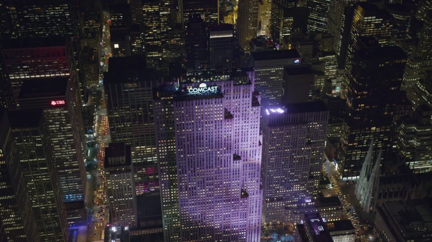 6K stock footage aerial video approach Rockefeller Center at Night in Midtown Manhattan, New York City Aerial Stock Footage | AX122_122