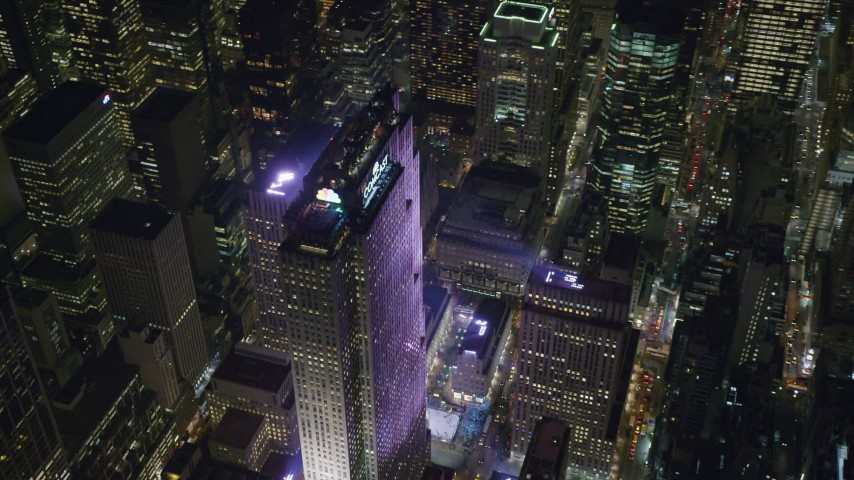 Orbiting Rockefeller Center and the Ice Skating Rink in Midtown at Night Aerial Stock Footage | AX122_123