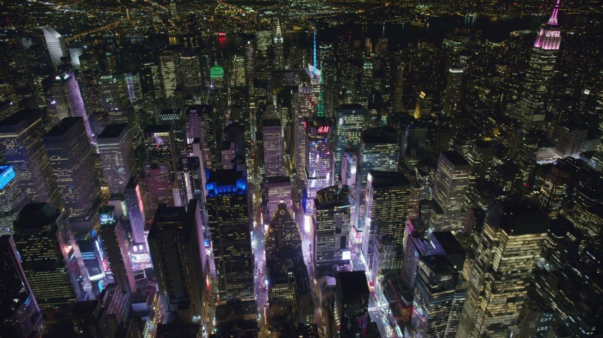 6K stock footage aerial video orbit skyscrapers around Times Square at Night in Midtown, New York City Aerial Stock Footage | AX122_126