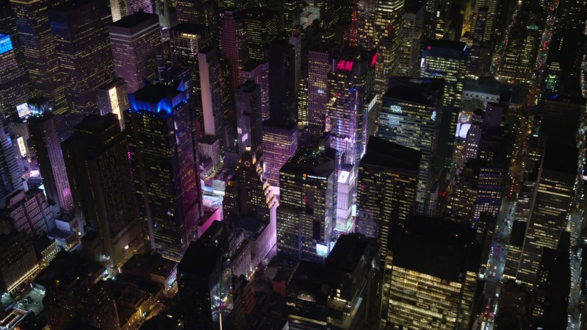Skyscrapers by Times Square at Night in NYC Aerial Stock Footage | AX122_127