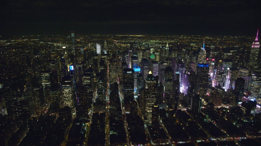 6K stock footage aerial video of orbiting Midtown skyscrapers around Times Square at Night in New York City Aerial Stock Footage | AX122_129