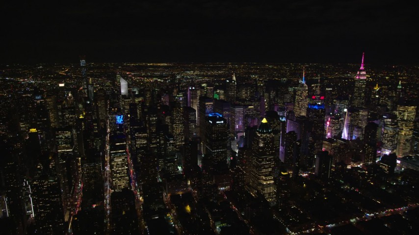 5.5K stock footage aerial video of orbiting Midtown skyscrapers around Times Square at Night in New York City Aerial Stock Footage   AX122_129E