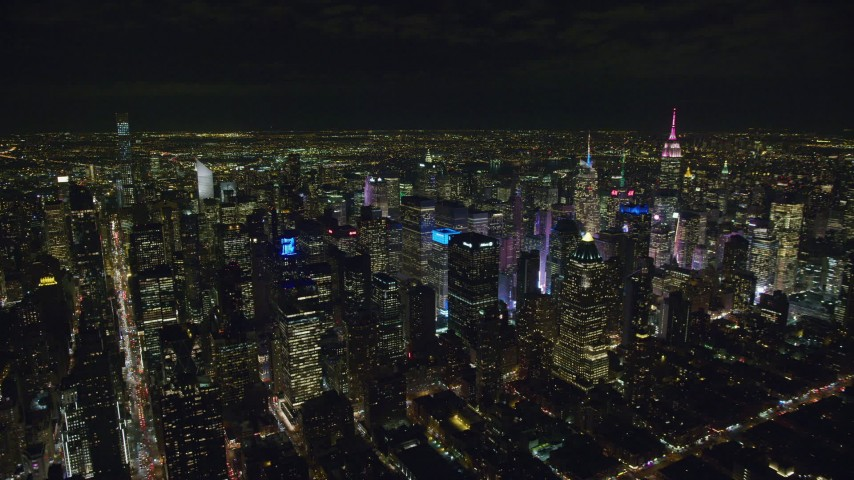 6K stock footage aerial video orbit of Midtown Manhattan skyscrapers at Night in New York City Aerial Stock Footage | AX122_130