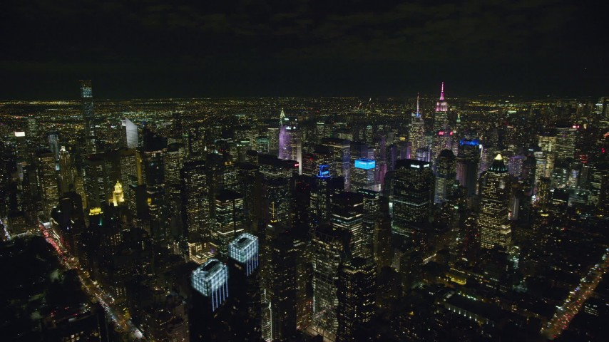 Flyby Midtown Manhattan Skyscrapers at Night in NYC Aerial Stock Footage | AX122_131