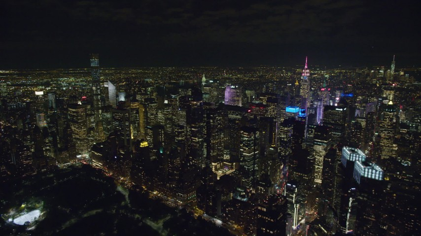 6K stock footage aerial video of a flyby of Midtown Manhattan high-rises at Night in NYC Aerial Stock Footage | AX122_132
