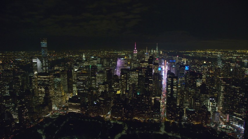 6K stock footage aerial video orbit Midtown skyscrapers at Night in New York City Aerial Stock Footage | AX122_133