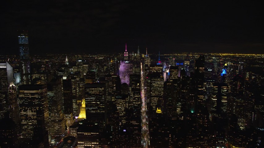 5.5K stock footage aerial video orbit Midtown skyscrapers at Night in New York City Aerial Stock Footage   AX122_133E