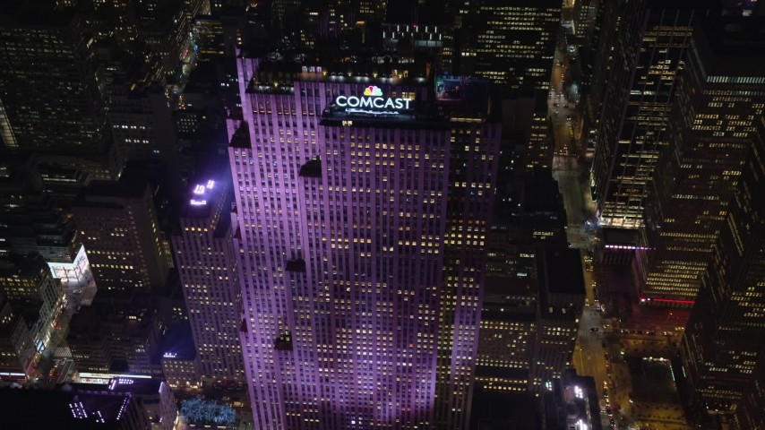 5.5K stock footage aerial video approach Rockefeller Center at Night in Midtown, New York City Aerial Stock Footage | AX122_136E