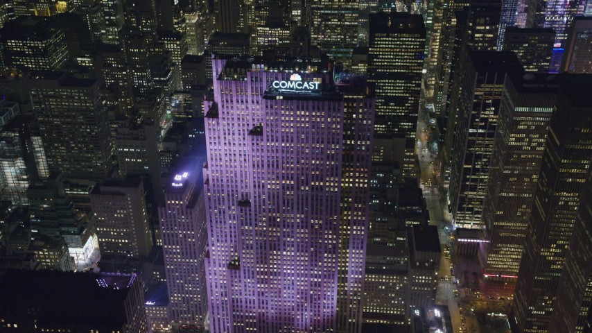 6K stock footage aerial video of approaching Rockefeller Center at Night in Midtown Manhattan, New York City Aerial Stock Footage | AX122_137