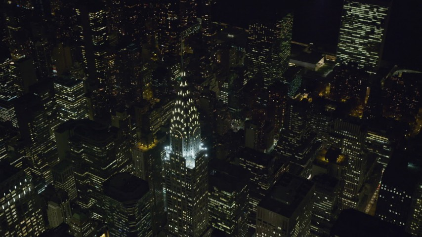 Orbiting Top of Chrysler Building at Night in Midtown Aerial Stock Footage | AX122_140