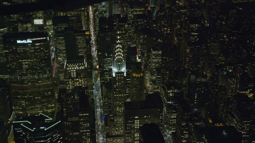 6K stock footage aerial video orbit the Chrysler Building lit for Night in Midtown, New York City Aerial Stock Footage | AX122_141