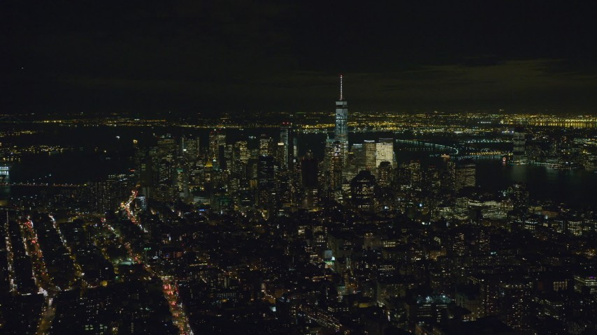 6K stock footage aerial video of skyscrapers in Lower Manhattan at Night in New York City Aerial Stock Footage | AX122_143