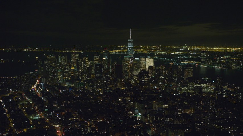 6K stock footage aerial video of tall skyscrapers in Lower Manhattan seen from East Village at Night in NYC Aerial Stock Footage | AX122_144