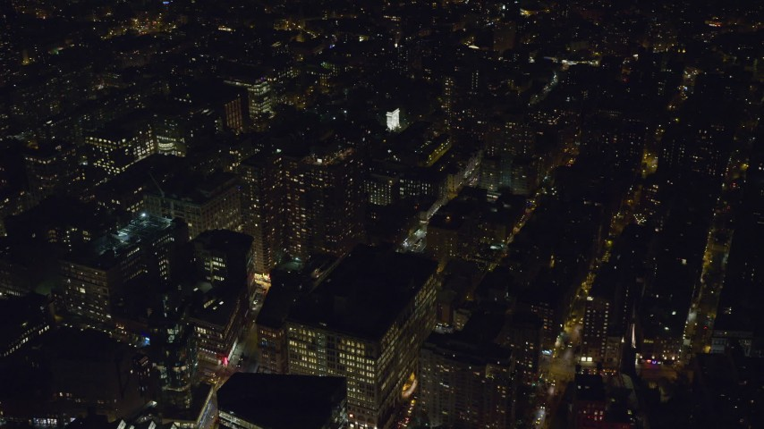 6K stock footage aerial video of office buildings and Washington Square Arch at Night in Greenwich Village, NYC Aerial Stock Footage | AX122_145