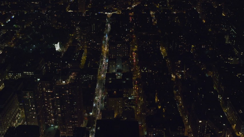 6K stock footage aerial video of city streets and apartment building near Washington Square Arch at Night, Greenwich Village, NYC Aerial Stock Footage | AX122_146