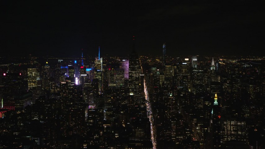 5.5K stock footage aerial video approach unlit Empire State Building at Night in Midtown, New York City Aerial Stock Footage   AX122_149E