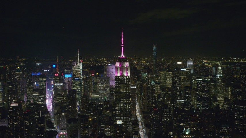 6K stock footage aerial video of a slow approach to the Empire State Building at Night In Midtown, New York City Aerial Stock Footage | AX122_152