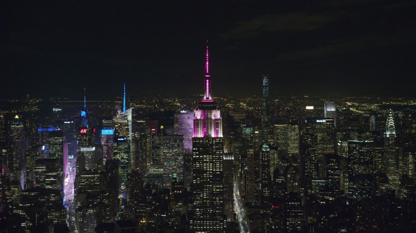 6K aerial video of approaching the Empire State Building at Night in Midtown Manhattan, NYC Aerial Stock Footage | AX122_153