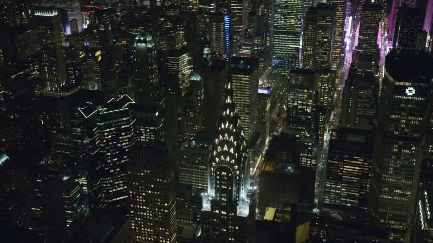Orbiting the Top of the Chrysler Building at Nighttime in Midtown Aerial Stock Footage | AX122_160