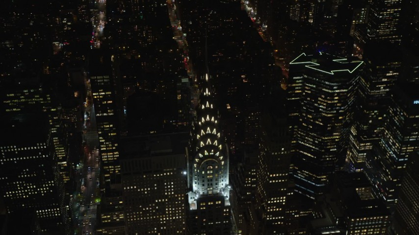 5.5K stock footage aerial video of orbiting the top of the Chrysler Building at Nighttime in Midtown, New York City Aerial Stock Footage   AX122_160E