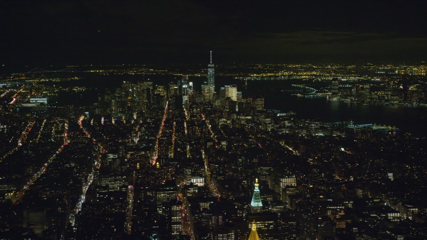 6K stock footage aerial video of approaching Lower Manhattan skyscrapers at Night in New York City Aerial Stock Footage | AX122_165