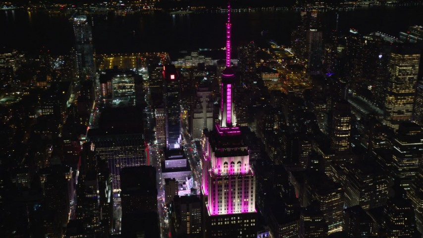 6K stock footage aerial video of orbiting the Empire State Building at Nighttime in Midtown, NYC Aerial Stock Footage | AX122_166