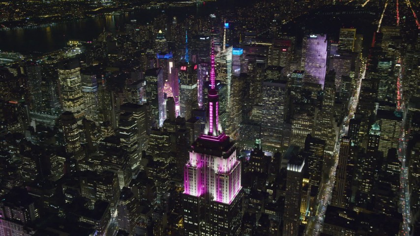 6K stock footage aerial video orbit the Empire State Building and zoom wider at Night, Midtown Manhattan NYC Aerial Stock Footage | AX122_167