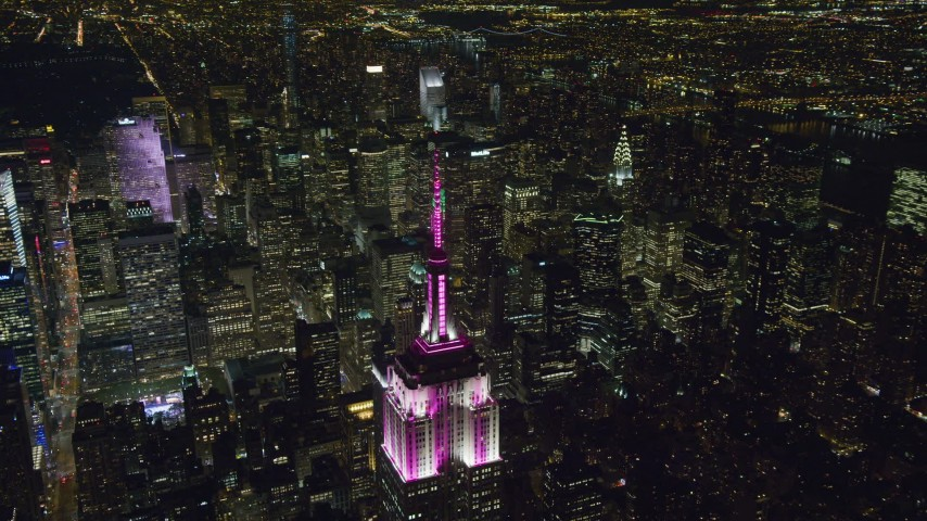 6K stock footage aerial video orbit of the Empire State Building at Night in Midtown Manhattan, NYC Aerial Stock Footage | AX122_168