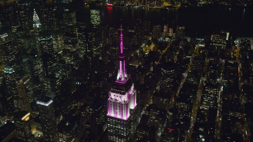 6K stock footage aerial video of circling around the Empire State Building at Night in Midtown Manhattan, NYC Aerial Stock Footage | AX122_169