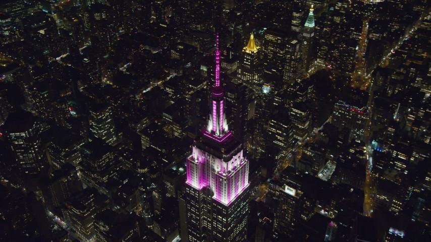 6K stock footage aerial video circle top of the Empire State Building at Nighttime in Midtown Manhattan, New York City Aerial Stock Footage | AX122_171