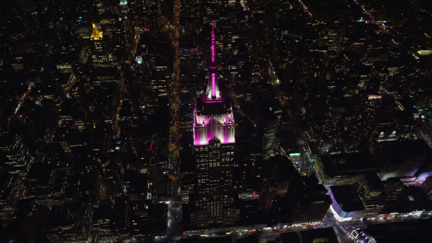 5.5K stock footage aerial video orbit the historic Empire State Building and Midtown streets at Night in NYC Aerial Stock Footage   AX122_172