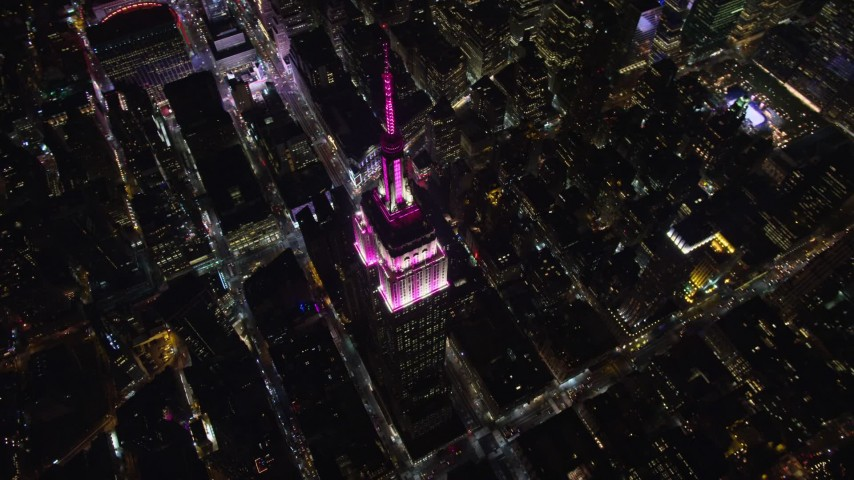 6K stock footage aerial video of a bird's eye orbit of the iconic Empire State Building at Night in Midtown Manhattan, NYC Aerial Stock Footage | AX122_173