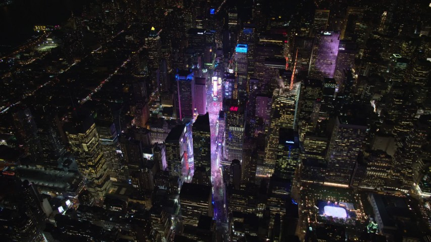 5.5K stock footage aerial video orbit and approach Times Square at Night in Midtown, New York City Aerial Stock Footage | AX122_174E