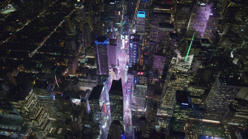 6K stock footage aerial video approach Times Square and tilt to the streets at Night in Midtown, NYC Aerial Stock Footage | AX122_175