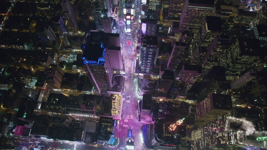 6K stock footage aerial video tilt to bird's eye of Times Square at Night in Midtown Manhattan, NYC Aerial Stock Footage | AX122_176